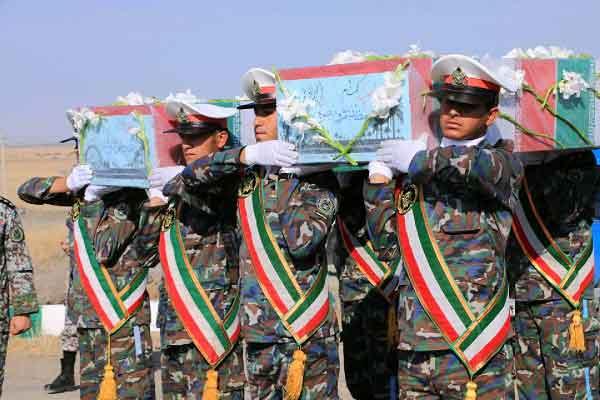 پیکرهای مطهر دو شهید گمنام در پایگاه پدافند هوایی قم خاکسپاری شد
